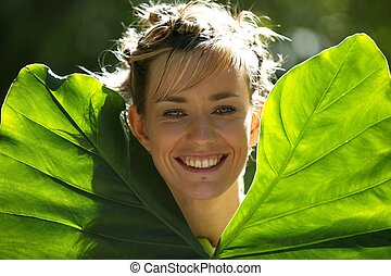 Woman holding big leaves