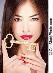 woman holding big old key