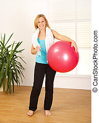 Woman holding big red ball