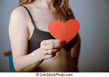 Woman holding big red heart