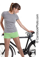 woman holding bike