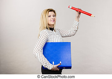 Woman holding binder with documents