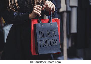 Woman Holding Black Friday Bag