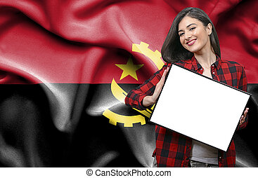 Woman holding blank board against national flag of Angola