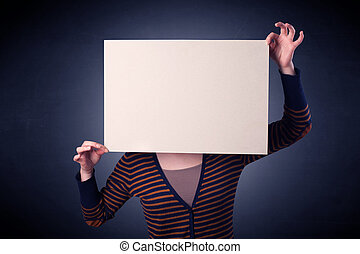 Woman holding blank paper - Young casual woman hiding behind...