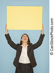 Woman holding blank sign.