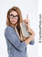 Woman holding books and pointing finger up