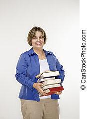 Woman holding books.