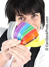 Woman holding brightly colored zips
