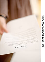 contract - Woman holding business contract to you, shallow...