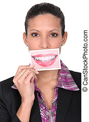 Woman holding card with smile