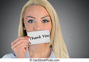 Woman holding card with Thank you word