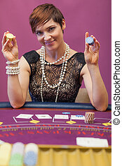 Woman holding chips in her hand in a casino