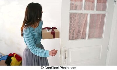 Woman holding Christmas gift box in her hands