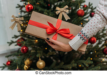woman holding christmas gift