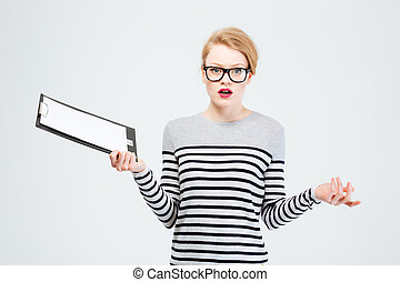 Woman holding clipboard and shrugging shoulders