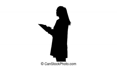 Woman holding clipboard - Side view of a young woman nodding...