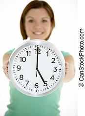 Woman Holding Clock Showing 5 O'Clock