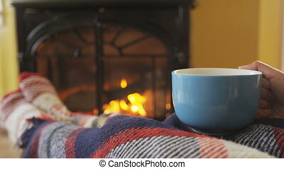 Woman Holding Coffee Cup By Fireplace At Home Drinking Hot ...