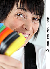 Woman holding colorful cable ties