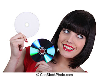 Woman holding compact discs on white background