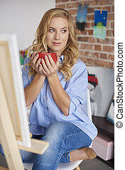 Woman holding cup of coffee in hands