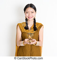 Woman holding Diwali light