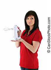 Woman holding electric whisk on white background