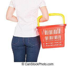 Woman holding empty shopping basket