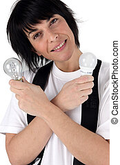 Woman holding energy saving light bulb