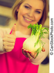 Woman holding fennel bulb