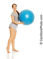 Woman holding fitness ball