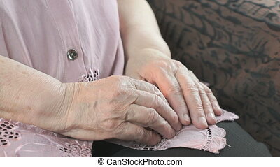 Woman holding flabby wrinkled hands of aged woman - Woman...