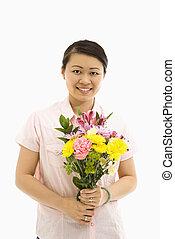 Woman holding flower bouquet.