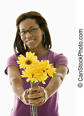 Woman holding flowers.