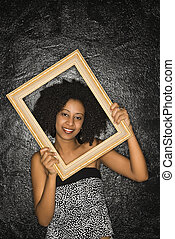 Woman holding frame.