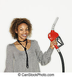 Woman holding gas nozzle - Portrait of pretty young woman ...