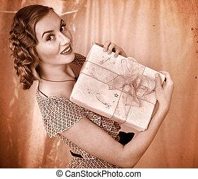 Woman holding gift box.