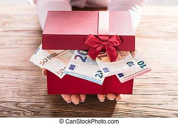 Woman Holding Gift Box Of Us Euro Bills