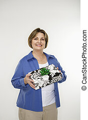 Woman holding gift.