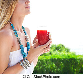 Woman holding glass of a strawberry juice