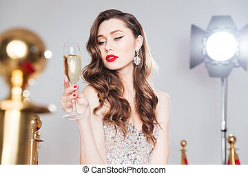 Woman holding glass of champagne