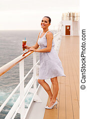 woman holding glass of cocktail on cruise