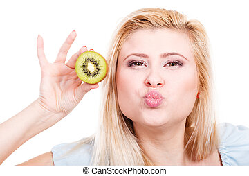 Woman holding green kiwi fruit