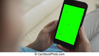 Woman Holding Greenscreen Smartphone - Young red-haired ...