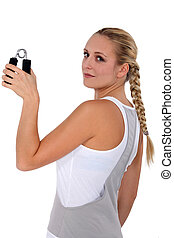 Woman holding grippers