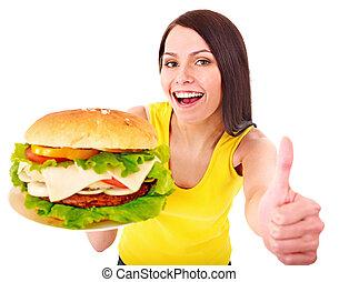 Woman holding hamburger. Isolated.