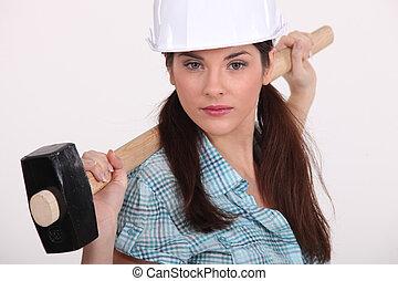 Woman holding hammer