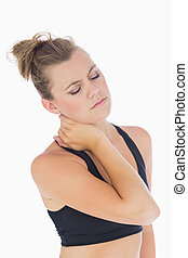 Woman holding hand to stiff neck