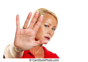 Woman holding hands in front of her face.